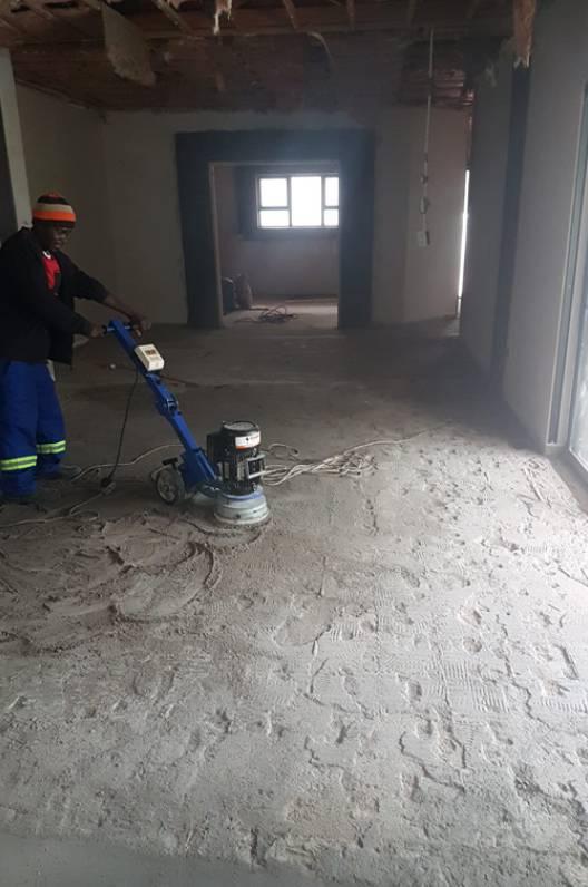Diamond grinding prepwork before epoxy floor application
