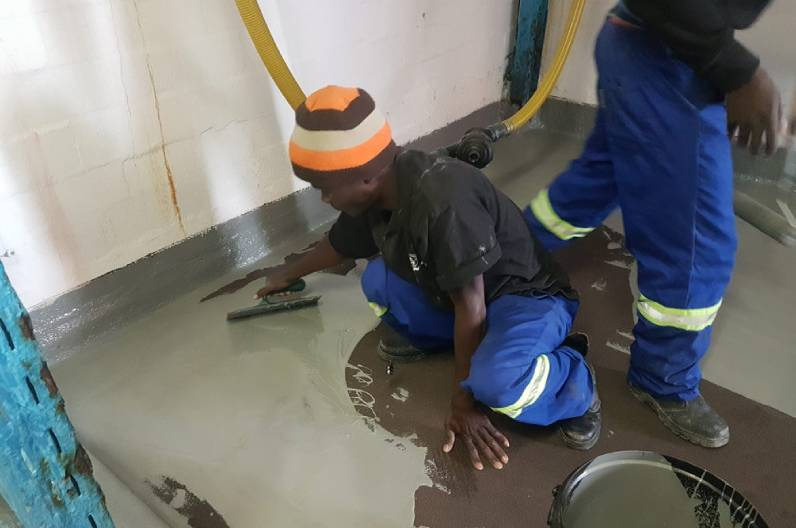 Industrial Epoxy Floor for an Acid Bay - Application Stage